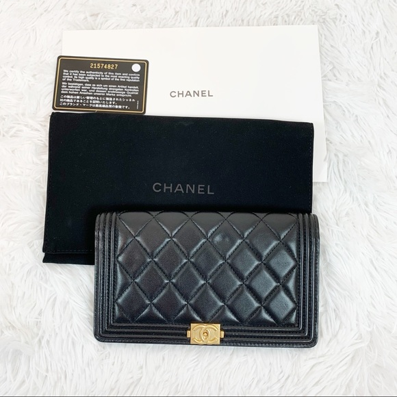 CHANEL Handbags - Chanel black quilted leather boy flap long wallet